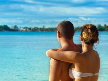 A cruise is an excellent option for couples to spend their honeymoon or a quick romantic getaway. After the stresses and rushing to get everything arranged for your wedding day, cruise getaways can offer the needed release from worry about details and just to enjoy the ride and be pampered. A cruise ship has many amenities and luxuries all in one place that you won't find in a resort or a single destination vacation, even if it is all inclusive. You don't have to be 'just married' to go an a honeymoon cruise either. Whether you are planning a honeymoon for the first time, a romantic wedding anniversary vacation, or just a romantic trip for the two of you, a romantic cruise can be an unforgettable experience. You will see breathtaking views every day, travel to many different exotic locales, get off the ship for day trips for some shopping and local restaurants, plus much more. You can even take a quick romantic cruise getaway while you are vacationing in a specific destination. If in the past you had written a romantic cruise off because of perceived expenses, then perhaps now is a good time to revisit the idea. Prices for many cruises have gone down as more options have come into the market and more cruise lines compete for your business. Even a romantic weekend getaway on a cruise can cost less than spending it on the town. You have the option for shopping around for the best deal or find the cruise that has the exact itinerary that you want. There are great cruises that will take you to the Caribbean, Mexican Riviera, the South Pacific, or the Mediterranean, each with a unique experience. You also will need to look at the ports-of-call of each cruise that tell you where the ship will stop for a day or so for the guests to get off and wonder about. A romantic cruise can be spoiled if there are many young children around which can happen especially during peak holiday seasons. As such, you may want to inquire whether a cruise ship has adults only areas or look for an adults only cruise. Additionally, you would not want to miss your cruise because of flight delays. So, depending on where your cruise departs from, you may want to have at least a day between your flight and the cruise departures. Here are some ideas for taking a romantic cruise: There are lots of choices if you want a quick weekend cruise getaway. For example, Princes Cruise Line offers 1 and 2 night options such as a 1 night Pacific coastal cruise between Vancouver, Canada to Seattle, Washington, or a 2 night Australia coastal cruise from Melbourne. Cruise to the Bahamas – If you are looking for a weekend cruise getaway then a Bahamas cruise is an excellent choice. Carnival and Celebrity cruise lines offer 2 and 3 night cruise options that depart from Florida. The cruise ship stops at Nassau, the capital of Bahamas. Baja, Mexico – Another great option for a weekend cruise is Baja, Mexico. The cruise departs from Los Angeles or Long Beach, California, USA and takes you down the Pacific coast into Baja California stopping at Ensenada, Mexico, a popular tourist city rich in Mexican and European culture, as well as American influence. If you are holidaying in Australia, then you may want to take a weekend Australian cruise which departs from Sydney. Celebrity Cruises offers a nice option for this short getaway. There are no other ports-of-call on this one. Caribbean cruise – The Caribbean offers many things to see and enjoy. This cruise logically is longer, between 5 and 7 nights, and has a number of ports-of-call such as Bahamas, Mexico, Puerto Rico, St. Maarten, and other stops, not all of them on the same cruise, of course, but at least 2 or 3 different ports-of-call on a single cruise. A romantic cruise can offer you a much needed R&R, a special time for the two of you to spend together, and spectacular scenery to enjoy. Whether you return to a hotel or your home, you will have wonderful memories to recall from your romantic cruise getaway.
